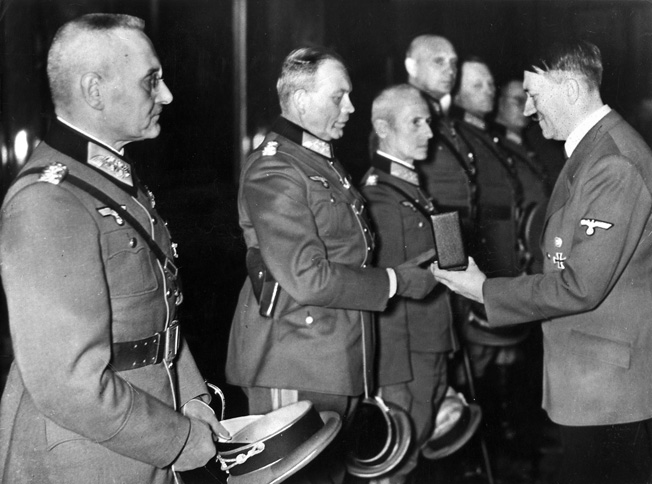 ADOLF HITLER (1889-1945). Chancellor of Germany, 1933-45. Awarding the Knight's Cross to generals Franz Halder, Heinz Guderian, Hermann Hoth, Adolf Strauss, Erich Hoepner and Friedrich Olbricht. Photograph, 27 October 1939.