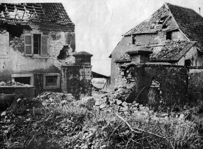 This photograph of the garden where American tanks occupied positions in Singling evidences the ferocity of the combat that took place there. The destroyed portion of the garden wall was taken down by a 105mm self-propelled howitzer commanded by Sergeant Robert G. Grimm. Troops under the command of 2nd Lt. William Cowgill fired bazookas from the attic of the house on the left through gaps in the roof tiles.