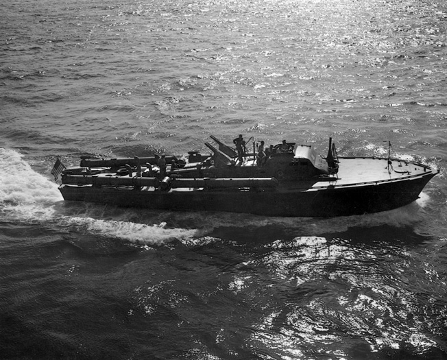An American PT-boat demonstrates its speed in open water in 1943. PT-boats were the first American surface units to engage the Japanese ships moving through Surigao Strait toward the landing beaches at Leyte.