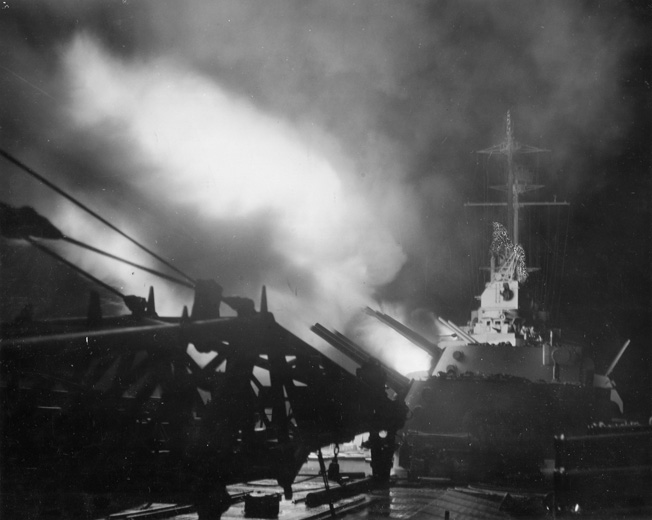 The new cruiser USS Columbia fires its weapons during a night exercise in 1943. As the war continued, U.S. Navy gunners became more proficient in night engagements, particularly with the addition of fire control radar aboard many ships.