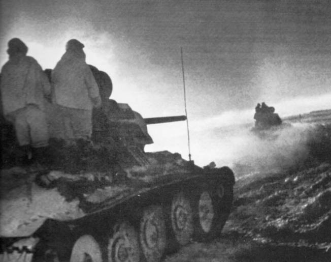 Dashing through snow and sub-freezing temperatures, Soviet infantry rides into battle atop tanks on December 16, 1942, during Operation Little Saturn, an all-out attempt to halt Manstein's advance on Stalingrad.