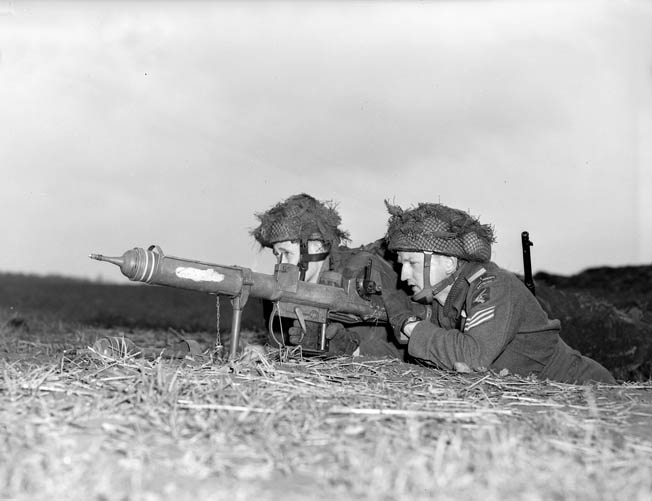 Two troopers of the 1st Canadian Parachute Battalion fire their PIAT antitank weapon at oncoming enemy armored vehicles near the town of Lembeck, Germany, in March 1945. Within weeks, World War II in Europe was over.