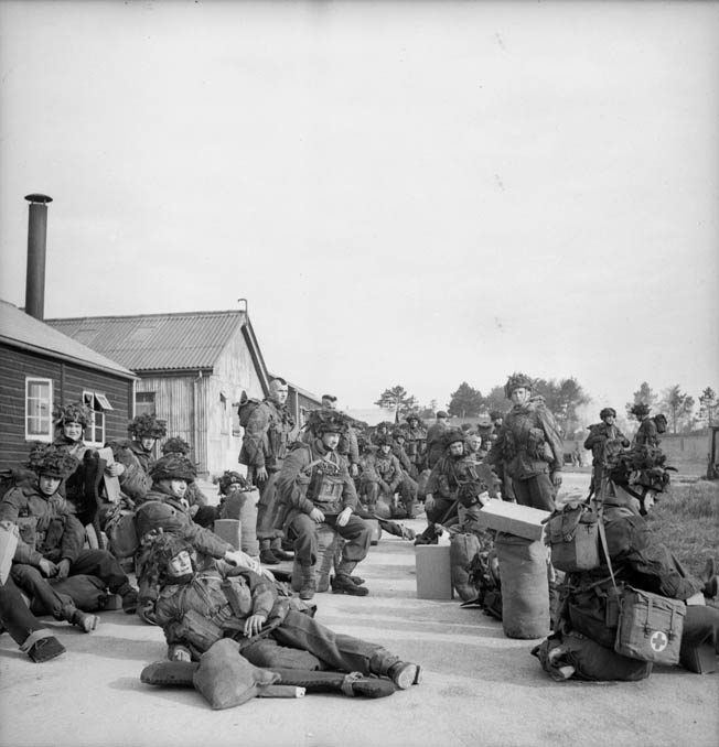 Troopers of the 1st Canadian Parachute Battalion relax in an assembly area as they await orders to proceed to their designated airfield and board transport planes for the perilous D-Day jump into Normandy.