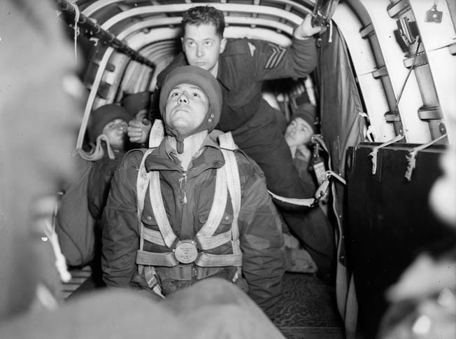 A private of the elite 1st Canadian Parachute Battalion prepares to jump from an Armstrong Whitworth Whitley bomber modified to carry paratroopers.