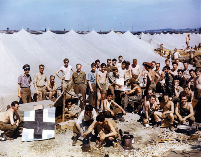 In this May 1945 photograph, recently liberated American prisoners of war await transportation during their journey home. Ray Miller was flown to Belgium and then transferred to Camp Lucky Strike near the port city of Le Havre, France, shortly after the German surrender and prior to his repatriation to the United States.