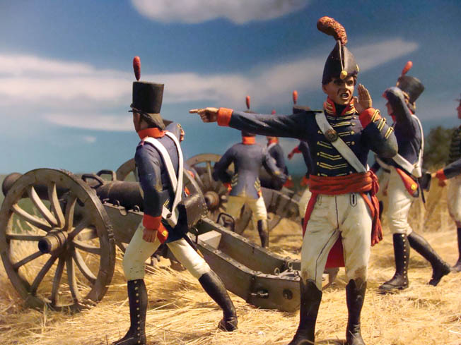 Marine gunners go into action in this diorama depicting the early history of the Corps.