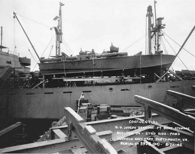 A navy photographer snapped a series of pictures on August 20, 1942 of PT-109 sitting on the deck of the Liberty ship Joseph Stanton in preparation for the voyage to Panama. The photo was taken at the Norfolk Navy Yard in Virginia.