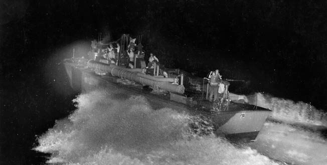 A PT boat crew goes through final shakedown during night training exercises in 1943. The boats were powered by three Packard V-12 engines that gave them a top speed of 65 mph.