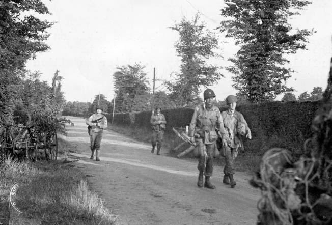 Four members of the 82nd enter the French village of Sainte-Mère-Église after their harrowing drop.