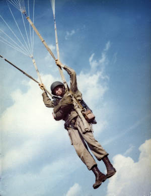 An American paratrooper floats to earth during a practice jump in 1942. Before dawn on June 6, 1944, paratroopers would be much more heavily equipped.