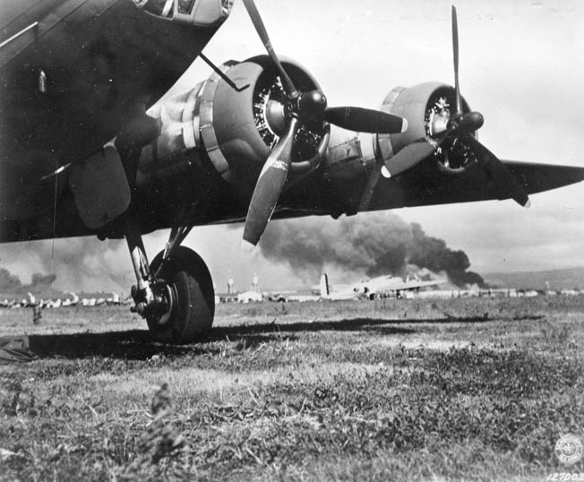 A flight of Boeing B-17 Flying Fortress bombers arriving from California was caught in the midst of the Japanese attack on Pearl Harbor. Several of the planes sustained serious damage or were destroyed. This photo taken at Hickam Field shows at least two of the bombers after their landing.