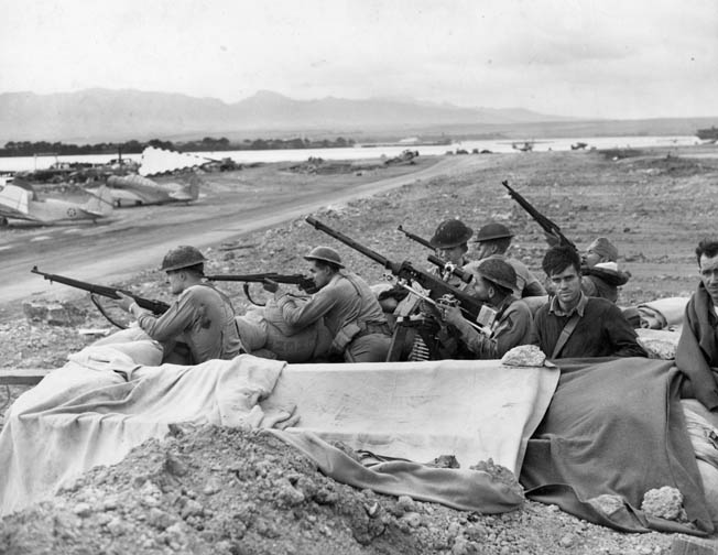 In the aftermath of the Pearl Harbor attack, U.S. Marines and soldiers stationed across Oahu were nervous and often fired at anything remotely suspicious. These troops man a sandbag gun emplacement adjacent to an airfield, their rifles and machine gun at the ready.