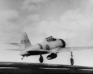 A Japanese Mitsubishi A6M Zero fighter fitted with an external fuel tank takes off from the flight deck of the aircraft carrier Akagi on the morning of December 7, 1941.