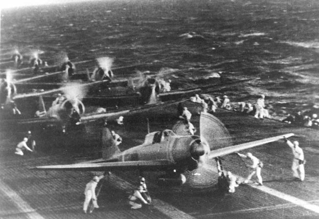 Japanese Mitsubishi Zero fighters prepare to launch from the aircraft carrier Shokaku at the start of second attack wave, December 7, 1941.