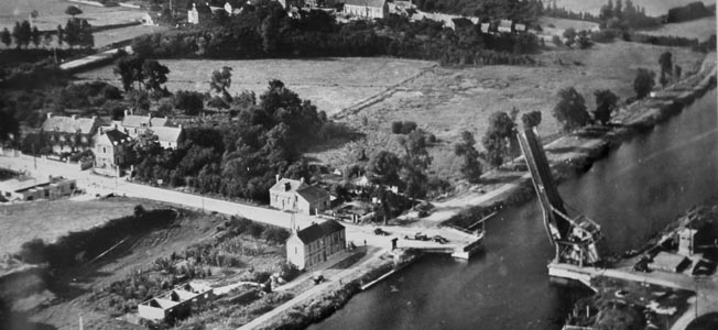 Taken some time after D-Day, this photograph depicts the bridge over the Caen Canal and the Café Gondree on the left bank. The café was turned into an aid station shortly after the action near Pegasus Bridge began.