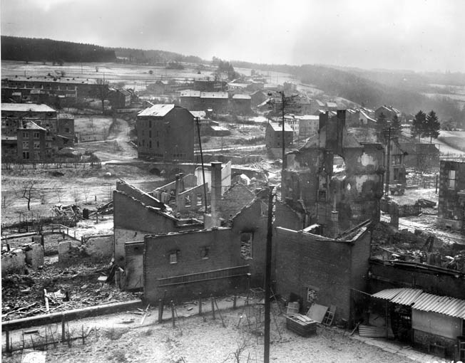 The shattered Belgian town of Stavelot is shown during the Battle of the Bulge. In the center at left is the bridge over the Ambléve River.