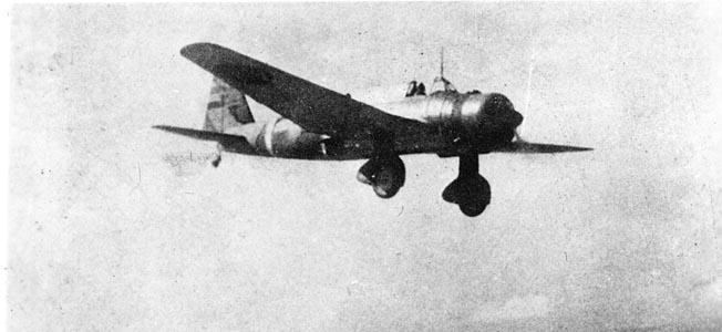 "A Mitsubishi Ki-51 Type 99 ""Sonia"" dive-bomber, comparable in size and performance to the German Stuka Ju-87 and U.S. Army Douglas A-24 ""Banshee"" (similar to the U.S. Navy SBD ""Dauntless""). This Sonia was photographed after a raid against targets on Luzon."