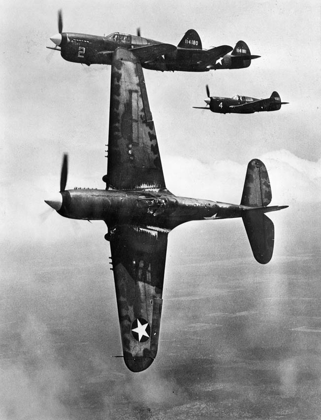 "The sturdy Curtiss P-40 ""Warhawks,"" shown here, with their liquid-cooled V-12 Allison engines, were outclassed by Japan's faster, more maneuverable Mitsubishi ""Zero"" fighter, but the American pilots made up for the P-40s shortcomings by being brave in the attack."