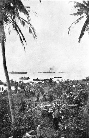 Invasion forces of General Masaharu Homma come ashore against scant opposition in Lingayen Gulf, December 1941.