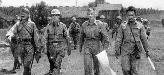 Under a flag of truce, American officers are led by their Japanese captors to conclude surrender terms on the Bataan Peninsula. General Douglas MacArthur was evacuated from the Philippines, and General Jonathan M. Wainwright surrendered American and Filipino troops to the Japanese. Under a flag of truce, American officers are led by their Japanese captors to conclude surrender terms on the Bataan Peninsula. General Douglas MacArthur was evacuated from the Philippines, and General Jonathan M. Wainwright surrendered American and Filipino troops to the Japanese.