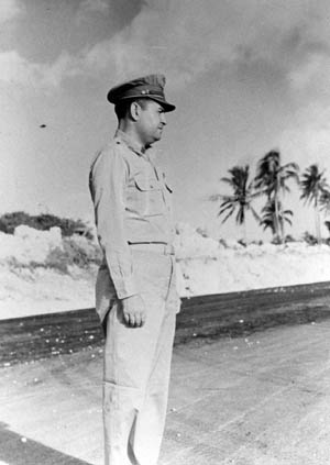 Maj. Gen. Curtis LeMay, head of the 21st Bomber Command, observes Tokyo-bound planes lifting off from Guam.