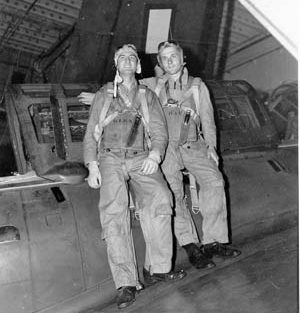 Posing on the hangar deck of the aircraft carrier USS Hancock (CV 19) to which they transferred after being aboard USS Ticonderoga (CV 14) are SB2C pilot Bill Klenk (left) and radioman-gunner Bill Hall.