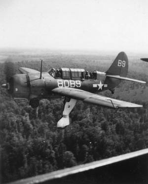 SB2C-1C Helldiver of Squadron VB-80 on approach for landing, with gear down.