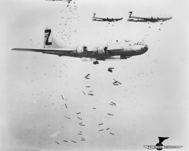 "Other cities were also targeted. Following up on the Tokyo raid, B-29s from 500th Bomb Group, 73rd Bomb Wing, drop incendiary bombs—dubbed ""Molotov flower baskets""—on Yokohama, near Tokyo, May 1945."
