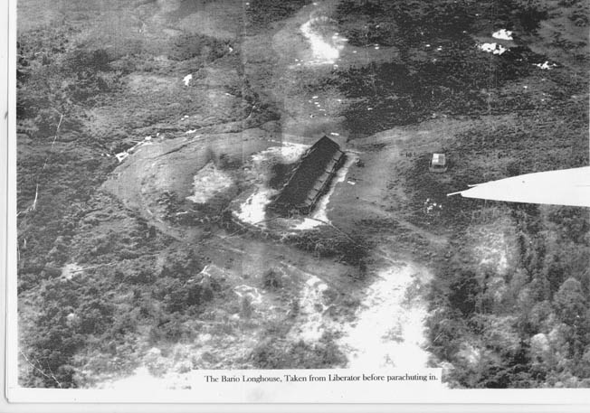Jack Tradrea, a member of the Z Special Unit, took this photograph from the B-24 bomber that transported the covert unit to Borneo. The image shows the longhouse where the group spent its first night in Borneo. Tradrea accompanied Tom Harrisson during this mission to the Japanese-held island.