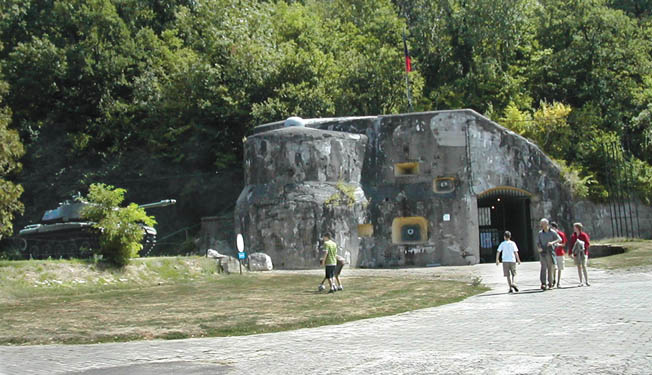 A view of Bloc 1, the main visitor entrance to Eben-Emael today. Scars caused by munitions are visible on the concrete.
