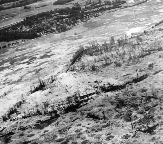 The Lonesome Polecat's target: the V-1 rocket depot and launching site at Siracourt, France, photographed in July 1944 after more than 25 heavy bombing missions by the Eighth Air Force and RAF; the site never went operational.