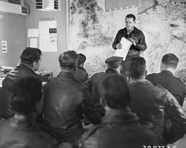 Colonel Edward J. Timberlake, commander of the 93rd, briefs combat crews before a mission.