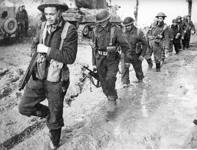 With victory in sight but heavy combat still ahead, Polish II Corps soldiers slog through mud somewhere in Italy in February 1945. The Poles acquitted themselves admirably throughout the Italian campaign.
