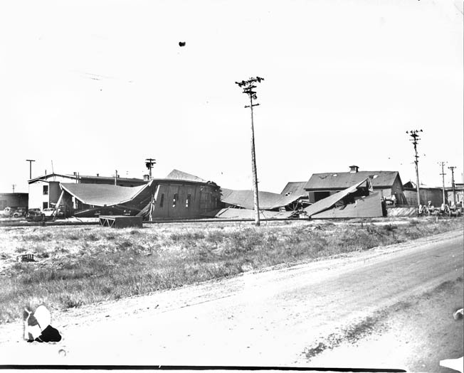Looking southwest, showing collapsed Building A-14 (Garage) in the center. Virtually every building at the port was either damaged or destroyed.