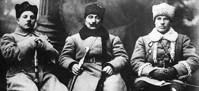 0111431 RUSSIAN CIVIL WAR  VETERANS:  Russian Civil War veterans Kliment Voroshilov (left), Semyon Budyonny (center), and Semyon Timoshenko(right). Photographed September 1920.