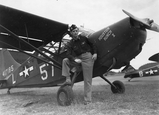 "Unit commander Major Tony Lala and his Piper L-4, ""Houston Hunch II."""