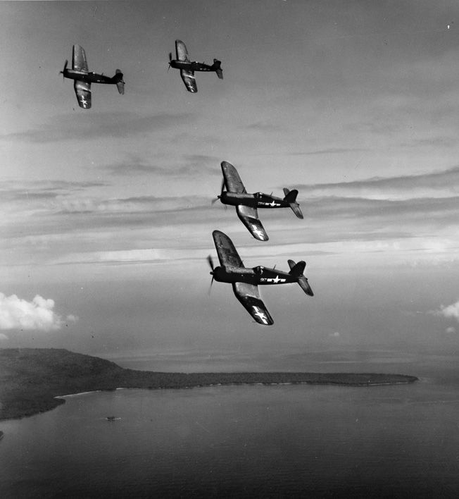 "A flight of Corsairs over a Japanese-held island, March 1944. In the hands of a skilled pilot, the F4U was equally adept at bombing, strafing, or aerial combat roles, and was called ""Whistling Death"" by the enemy."
