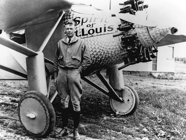 Lindbergh was photographed with the famous Spirit of St. Louis after his history-making 1927 flight to Paris.