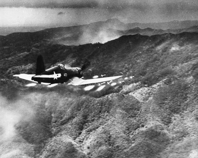 A Marine Corsair fires a salvo of rockets at Japanese positions on Okinawa.