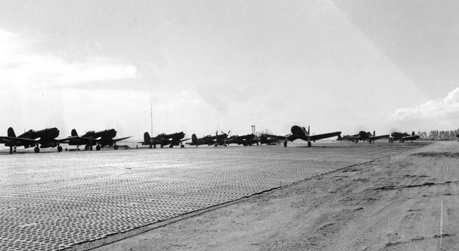 A squadron of Corsairs prepares to take off from an unidentified island airfield. Foss's unit was one of 145 Marine squadrons that took part in the Pacific campaign.