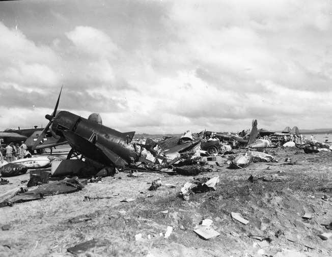 The victims of crash landings, these Marine Corsairs in a Leyte scrap yard were salvaged for parts.