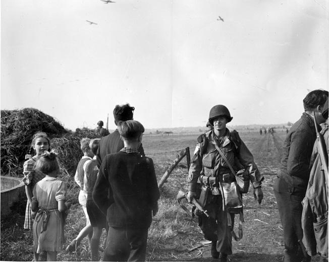Happy Dutch civilians greet their 101st Airborne Division liberators near Zon, September 18, 1944.