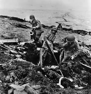 A U.S. mortar crew on Attu lobs its ordnance against a Japanese position.