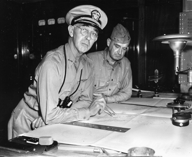 Surprised brass: Admiral Richmond Kelly Turner (left) and USMC Major General Alexander Vandegrift confer aboard the USS McCawley shortly before the Japanese attack.