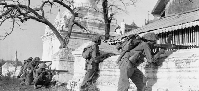 Soldiers of the 19th Indian Division pour fire into Japanese positions among the pagodas on Mandalay Hill, March 10, 1945.