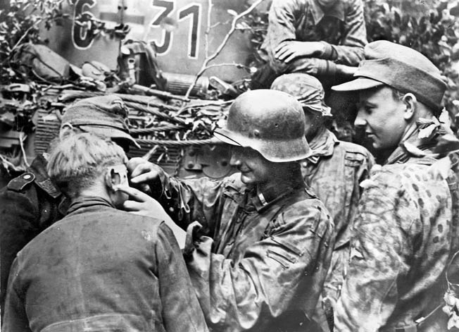 A member of the 12th SS Panzer Division (Hitlerjugend) has his facial wound treated. The 12th SS Panzer Division was the Canadians' toughest, most ruthless opponent during battle for Normandy.