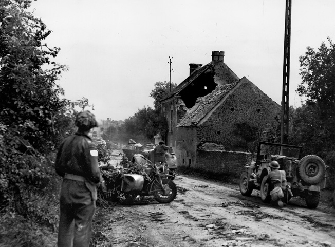 Canadian troops ambush a German convoy in a French village in Normandy.