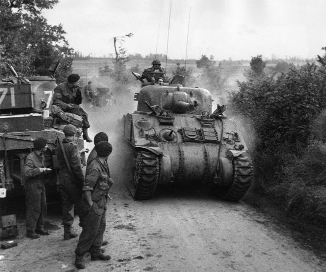 Grizzly tanks of the Canadian 3rd Armored Brigade kick up dust as they roll toward the front in Normandy.
