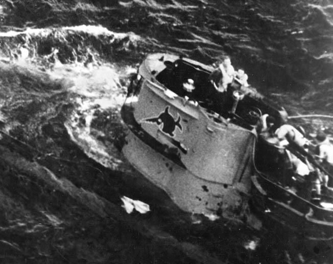 After being attacked by American aircraft on August 9, 1943, the crew of U-664 prepares to abandon ship.