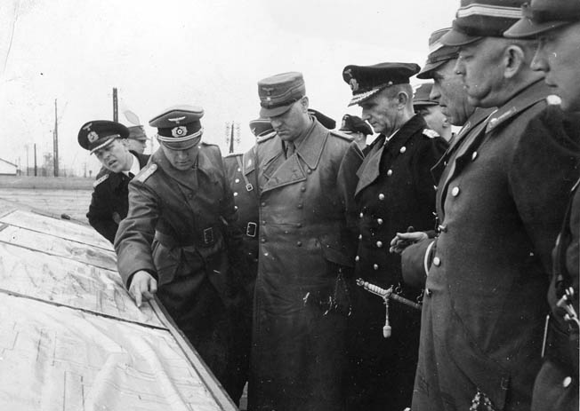 Admiral Karl Dönitz (right), head of the Kriegsmarine, discusses strategy with staff members.